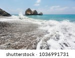 a wave on the beach near the... | Shutterstock . vector #1036991731