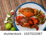 Simple Soft Shell Crabs boiled with seafood sauce on a white plate