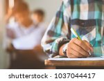 students writing and reading... | Shutterstock . vector #1037044417