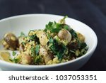 yellow rice with mushrooms and... | Shutterstock . vector #1037053351