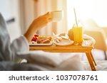 breakfast in bed  cozy hotel... | Shutterstock . vector #1037078761