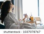 breakfast in bed  cozy hotel...   Shutterstock . vector #1037078767