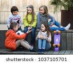 group of junior school children ... | Shutterstock . vector #1037105701