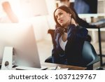 a girl working in the office... | Shutterstock . vector #1037129767