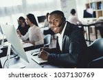 a black guy works in a call... | Shutterstock . vector #1037130769