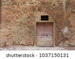 old door in ancient medieval...   Shutterstock . vector #1037150131