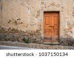 old door in ancient medieval...   Shutterstock . vector #1037150134
