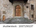 old door in ancient medieval...   Shutterstock . vector #1037150137