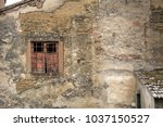 old window in aged brick... | Shutterstock . vector #1037150527