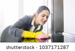 portrait of woman cleaning... | Shutterstock . vector #1037171287