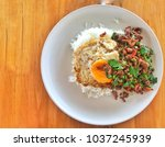 thai food rice topped with stir ... | Shutterstock . vector #1037245939