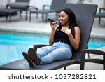 black female on a speaker phone ... | Shutterstock . vector #1037282821