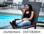 black female on a speaker phone ... | Shutterstock . vector #1037282824