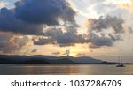 sunset at sea  mountains in... | Shutterstock . vector #1037286709