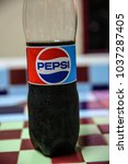 Small photo of LAMPHAYA,NAKHONPATHOM/THAILAND - 2018 March 16: Pepsi bottle with a drop of waterPepsi is a carbonated soft drink produced and manufactured by PepsiCo Inc. on Merch 16 , 2018 Thailand.