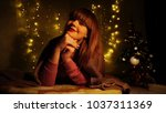 beautiful girl in plaid blowing ... | Shutterstock . vector #1037311369