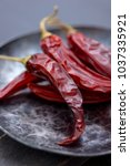 close up red chilli pepper in... | Shutterstock . vector #1037335921