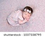 lovely newborn girl in dress... | Shutterstock . vector #1037338795