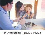 doctors advise mother how to... | Shutterstock . vector #1037344225