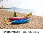 kayaks on sand beach | Shutterstock . vector #1037373319