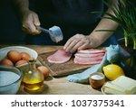 cook is preparing meat for... | Shutterstock . vector #1037375341