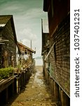 Small photo of street with tide in oldtown, thailand, koh lanta island