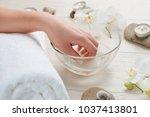 soak nails in warm bath.... | Shutterstock . vector #1037413801