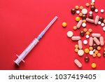 the different pills and syringe ... | Shutterstock . vector #1037419405