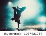 young man break dancing in club ... | Shutterstock . vector #1037421754