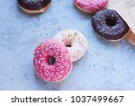 donuts with icing on pastel... | Shutterstock . vector #1037499667