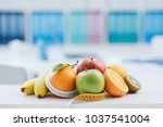 fresh healthy fruits and tape...   Shutterstock . vector #1037541004