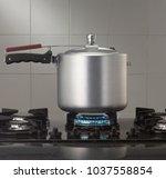 pressure cooker for kitchen | Shutterstock . vector #1037558854