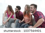 group of smiling young people... | Shutterstock . vector #1037564401
