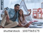 selfie with dad. young father... | Shutterstock . vector #1037565175