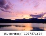sunset sky over mountain at... | Shutterstock . vector #1037571634