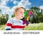 young boy with toy in hands ... | Shutterstock . vector #1037584369