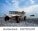 cart on wheels for descent of... | Shutterstock . vector #1037591239