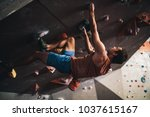 athletic man bouldering at an...   Shutterstock . vector #1037615167