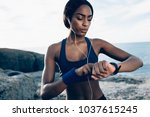 fit female runner using smart... | Shutterstock . vector #1037615245