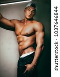 young sexy muscular man | Shutterstock . vector #1037646844