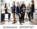 business people having a... | Shutterstock . vector #1037647567