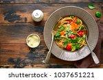 whole grain pasta primavera on... | Shutterstock . vector #1037651221