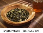 tea leaves on the wooden bowl | Shutterstock . vector #1037667121