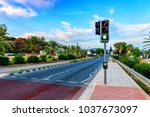 green light on traffic light and road - stock photo