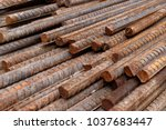 stack of rusty iron rods or bars | Shutterstock . vector #1037683447