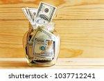 dollars money in a glass jar on ... | Shutterstock . vector #1037712241