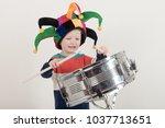 happy caucasian child drummer... | Shutterstock . vector #1037713651