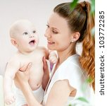 young mother with a charming... | Shutterstock . vector #103772285