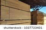 timber in warehouse | Shutterstock . vector #1037723401