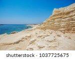 white cliffs. sea caves near... | Shutterstock . vector #1037725675